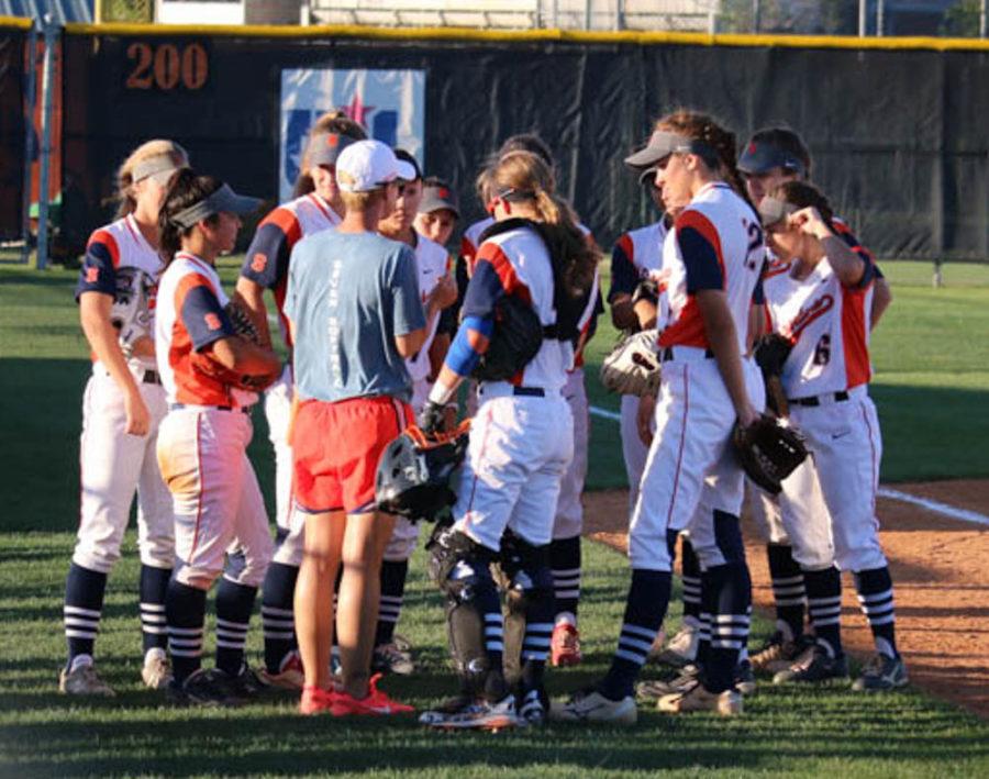 Coach+Spencer+gives+the+team+a+pep+talk+in+between+innings.