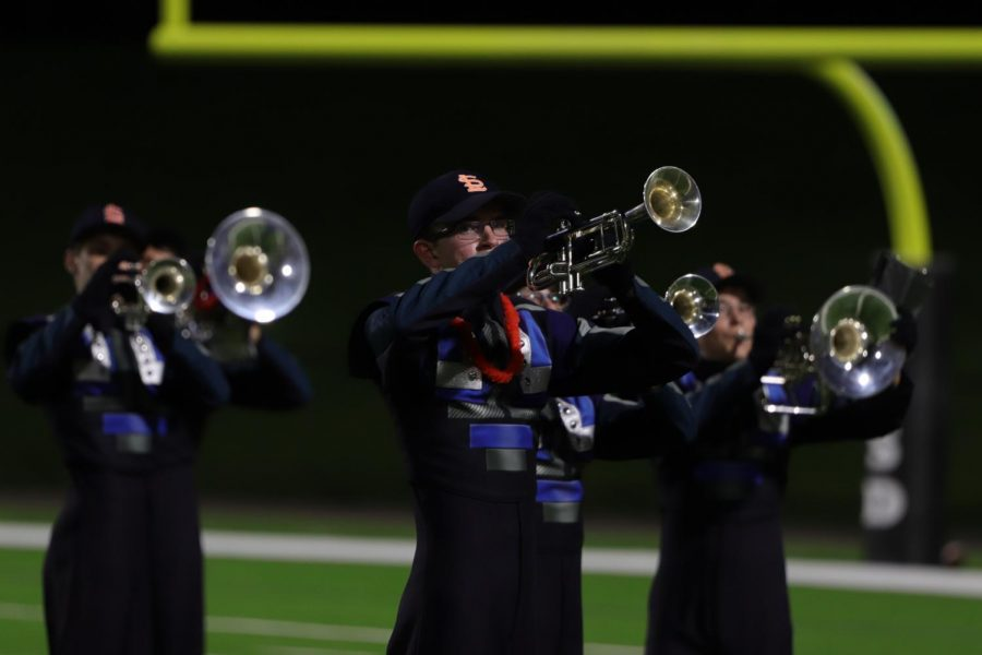 Daniel Fox marches and plays the trumpet in the halftime show in the first Seven Lakes varsity football game versus Memorial.